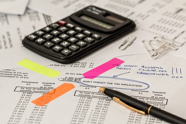 Calcalutor, paper and tax calculations