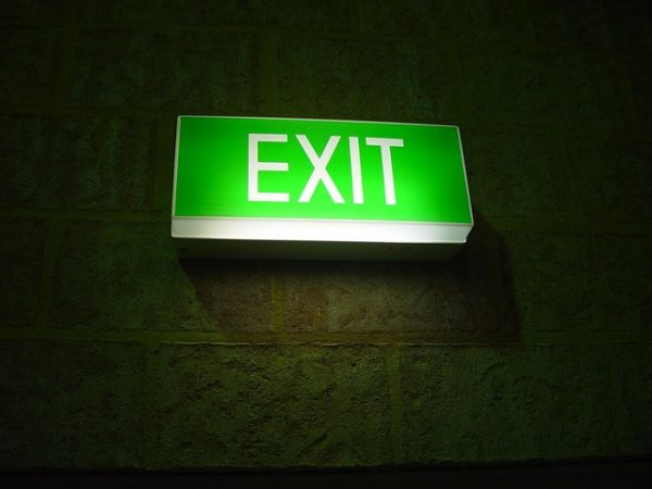 Glowing sign representing exit fees