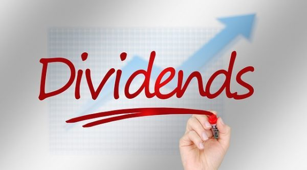 Investment trust dividends: Hand writing dividends in red marker