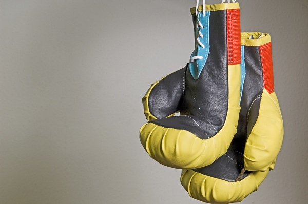 Key Informantion Document KID, Two yellow boxing gloves hanging down, Image from Pixabay