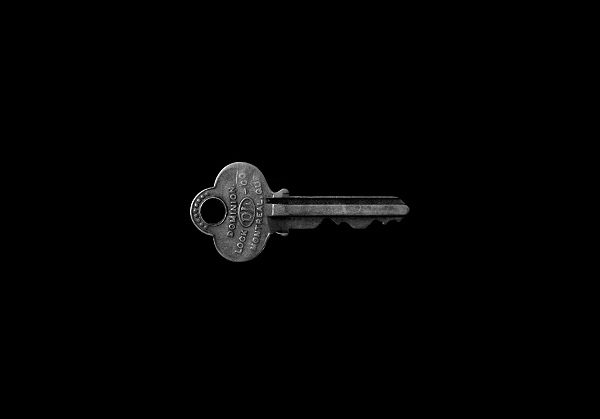 Key Information: picture of a single key against a black background, Photo by Matt Artz on Unsplash
