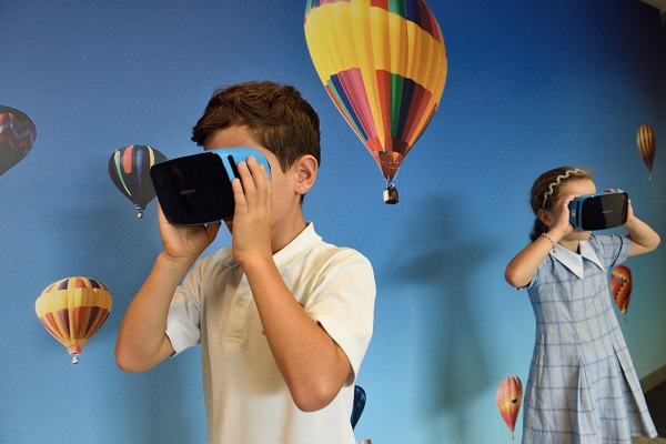 Technology investment trusts, Boy and girl wearing VR googles, Photo by STEMShare NSW on Unsplash