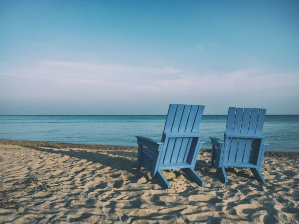 LifeStrategy and Target Retirement funds, two chairs on a beach, Photo by Aaron Burden on Unsplash