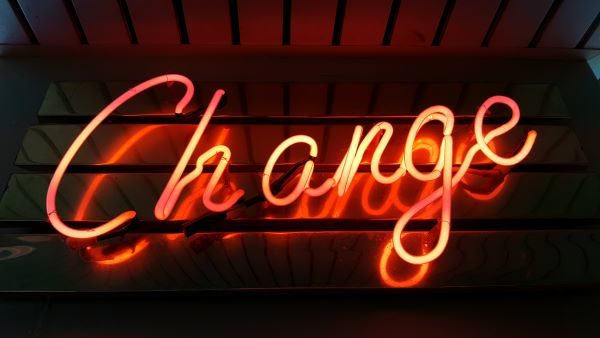 Investment trust sectors, neon sign saying Change, Photo by Ross Findon on Unsplash