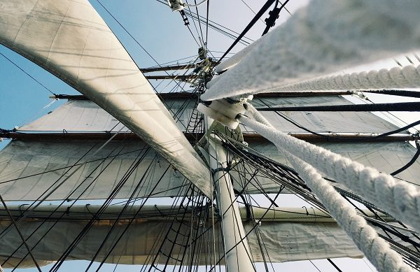 Caledonia Investments, looking up at a ship's rigging, Photo by Tanner Mardis on Unsplash