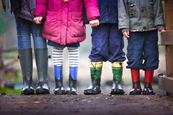 Junior ISAs, Photo of four children's legs by Ben Wicks on Unsplash