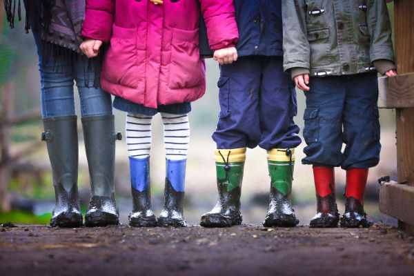 Junior ISAs, Photo of four children's legs by Ben Wicks on Unsplash