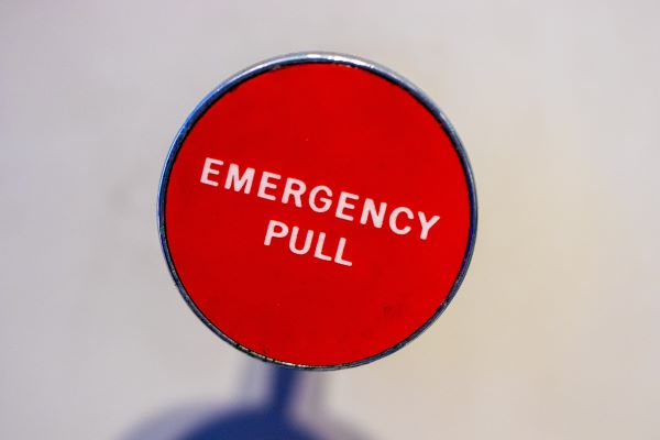 Emergency button, Photo by Jason Leung on Unsplash