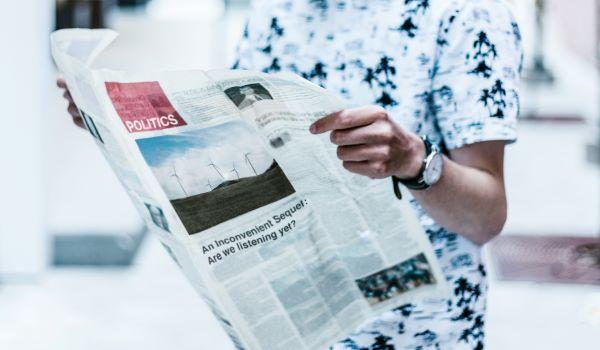 Man reading a newspaper, Photo by Priscilla Du Preez on Unsplash
