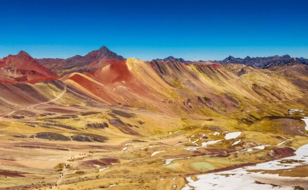 Investment trust millionaires, Vinicunca Rainbow Mountain in Peru by Eddie Kizka via Unsplash